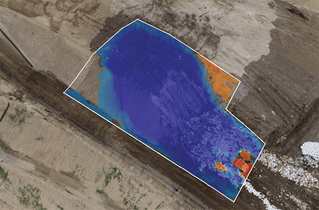 Цифровой снимок с наложением цвета, демонстрирующий степень уплотнения отходов в мусорных ячейках